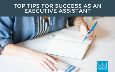 A person writing Top Tips for Success as an Executive Assistant in a notebook